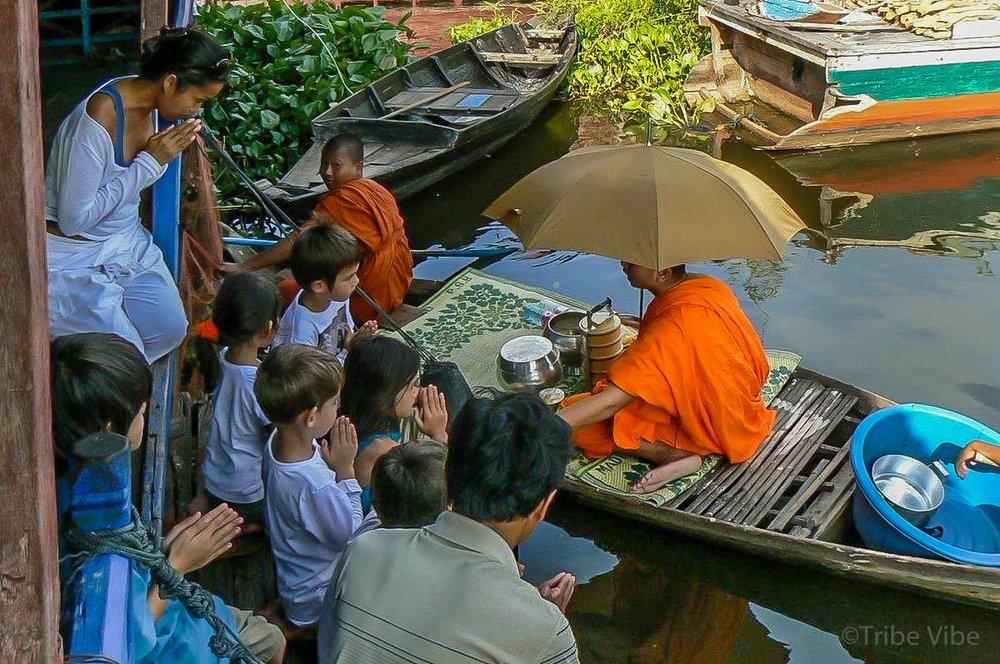 monk alms kids Tonle Sap
