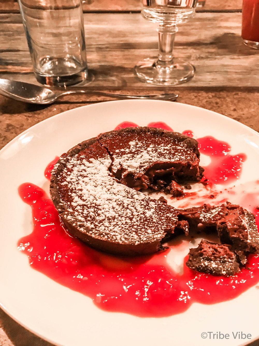 Dubai cooking class experience at Top Chef. Chocolate tart with raspberry coulis.