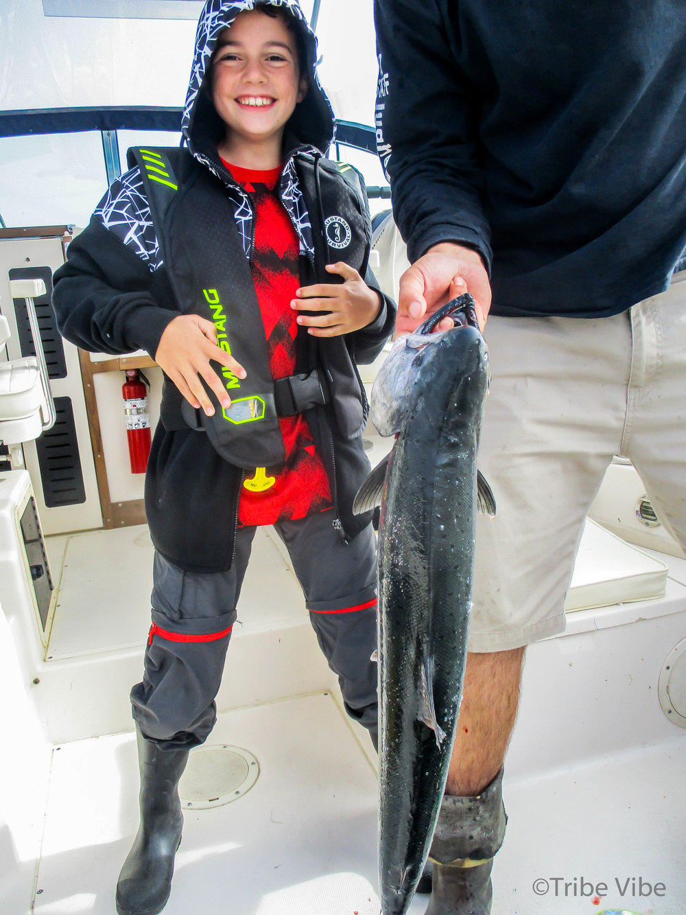 One very excited boy with the biggest catch of the day (for our family,) a 7kg Chinook Salmon!