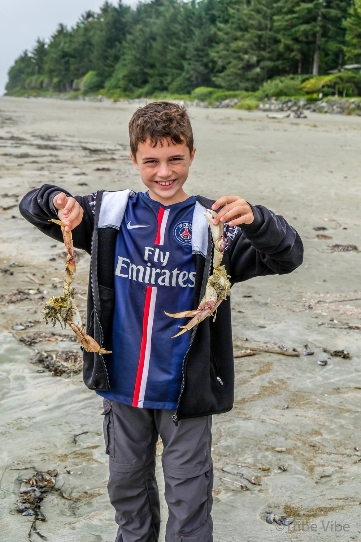 Finding crabs on Chesterman beach, Tofino, BC
