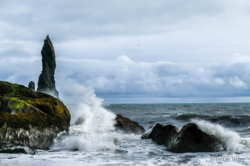 Basalt pillars rising from the sea in Iceland. RV road trip through Iceland.