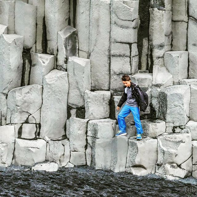 Kids love to climb everything and anything #themoredangerousthebetter Nature makes the best obstacle courses with very little regard to safety which is why #kidsloveit Even the coolest of the cool teens can't refrain from trying to leap the  #basaltcolumns at #Reynisfjara in #iceland #familyadventures