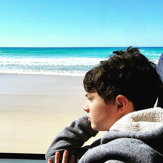 Caught in the act of #daydreaming . Love seeing the kids a million miles away in their thoughts. Watching whales and dolphins jumping, people in hip-waiters fishing, a dingo pass by, and all the beautiful colours of blue as we drive the #75milebeach #sandhighway on #fraserisland