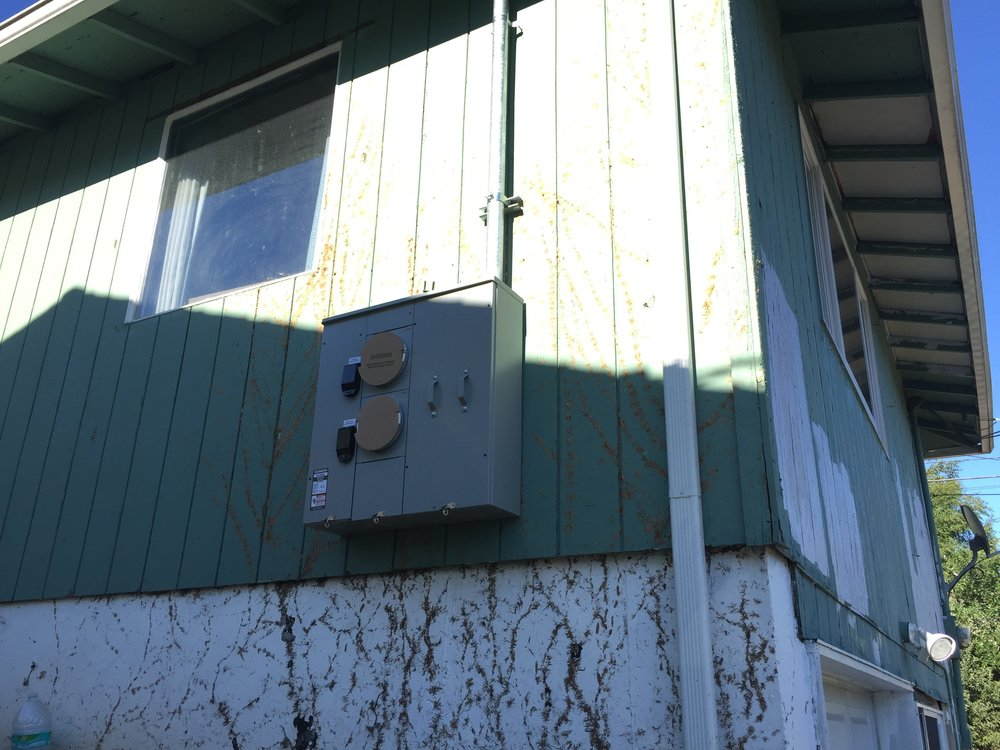 A dual pac or two pack meter head was installed on the exterior of the house. One meter will feed the panel for the upstairs unit. One meter will feed the panel for the downstairs unit.