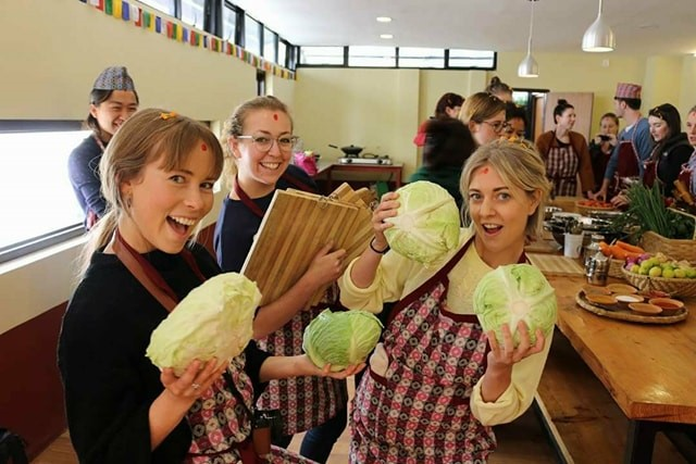 Chopping cabbage to prepare 'momos', a traditional Nepalese Dish