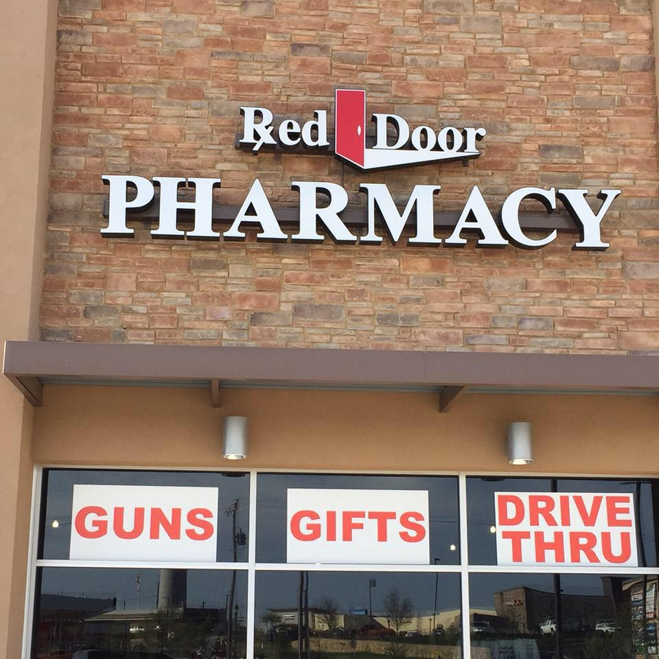 Store front; Guns, Gifts, Drive Thru