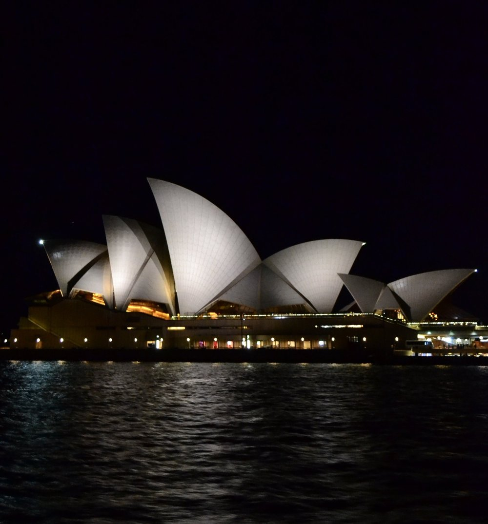 A STUNNING VIEW OF THE SYDNEY OPERA HOUSE AT NIGHT ABOARD A PASSENGER FERRY TO KIRRIBILLI
