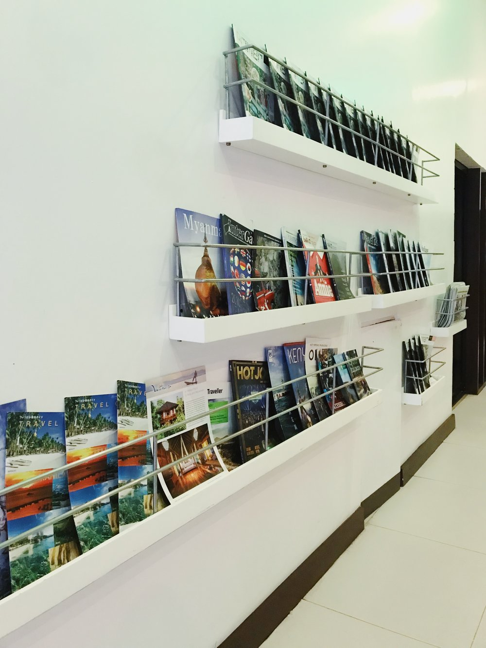 Magazines and newspapers are available for reading pleasure.