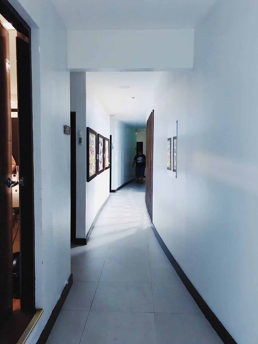 The hallway leading to the rooms. The door on the left is the shower room.