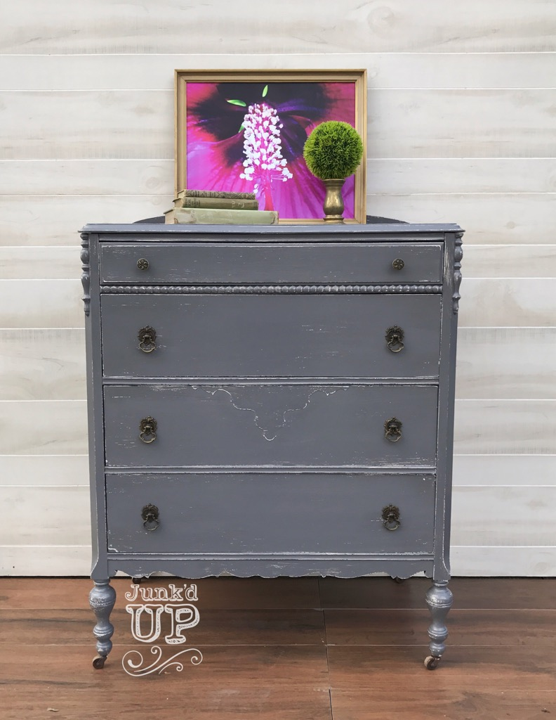 Grey Matters - This client was looking to take a forgotten dresser into the 21st century to be used in an entry foyer. Wanting to keep the palette neutral, she also wanted a little personality. We used a layered paint technique and artful and well placed distressing to breathe life and movement into this piece.