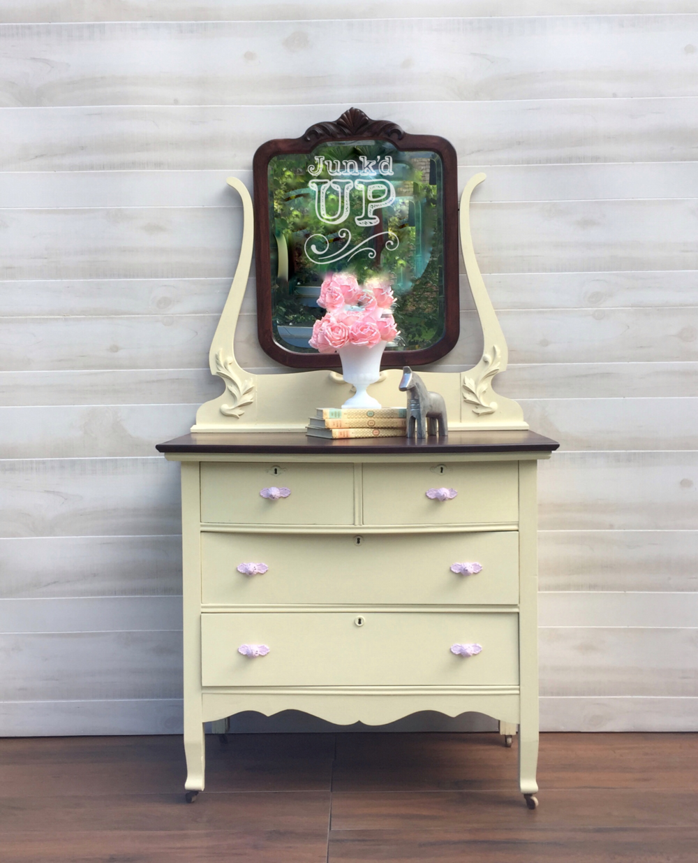Nursery Dreams - My client trusted me with a family heirloom. She requested a pale yellow paint complemented by a cherry stained top and mirror. After making adjustments for new hardware and fresh paint, we delivered.