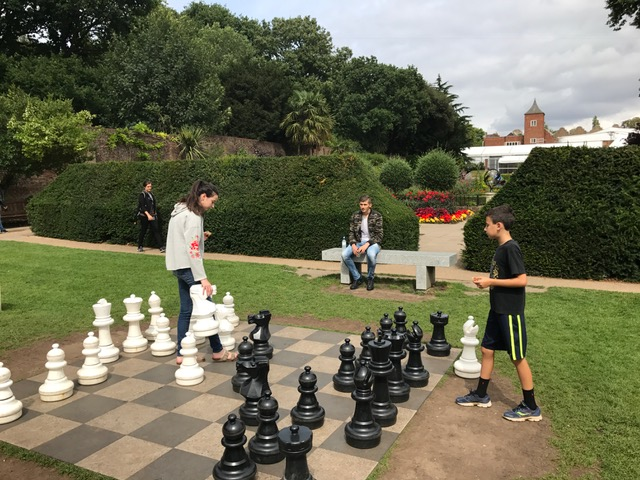 The kids playing chess in Holland Park.