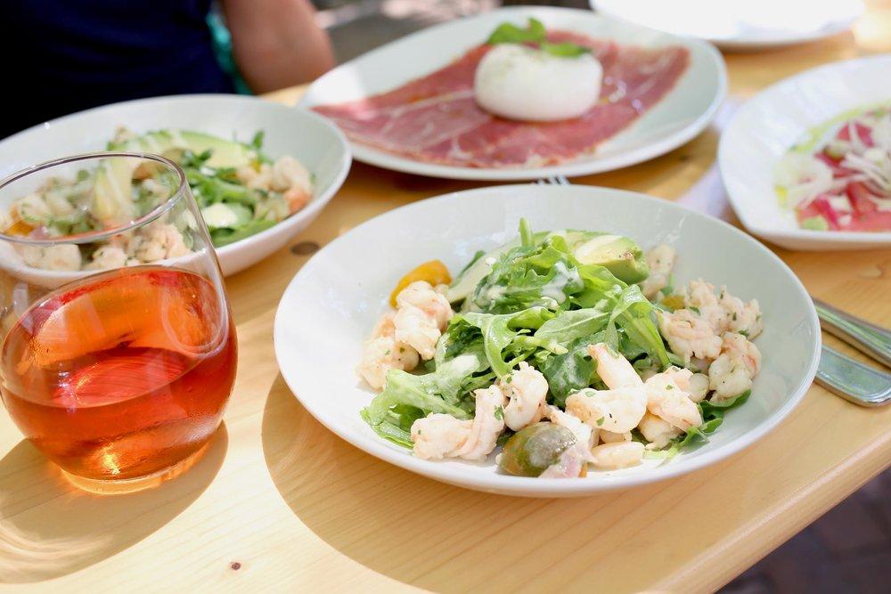 AVOCADO SAN PIETRO: Avocado and baby shrimp, arugula, grape tomatoes, cannellini beans, champagne-mustard sauce