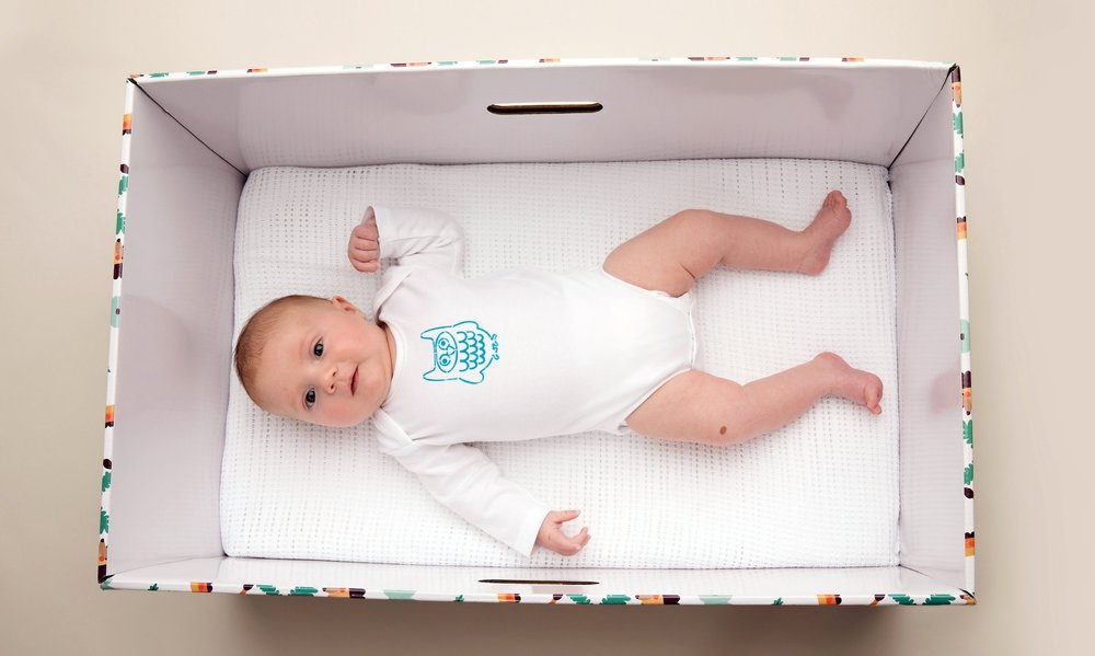 My first baby box laying in finnish babybox.jpg