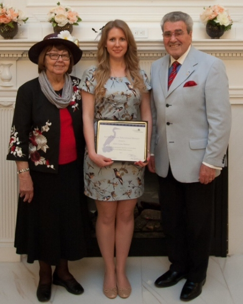 Picture: Dr. T.J (Jock) Murray and Janet Murray present the Suellen Murray Educational Bursary to Claire Halstead, Ph.D. at the Victoria Day Tea Party.