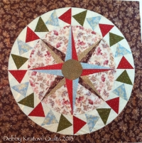 """Coffee Filter Mariner's Compass No kidding! Click that title to see several more. We use 20"""" coffee filters for the paper pieced center. And we paper piece the ring of Flying Geese."""