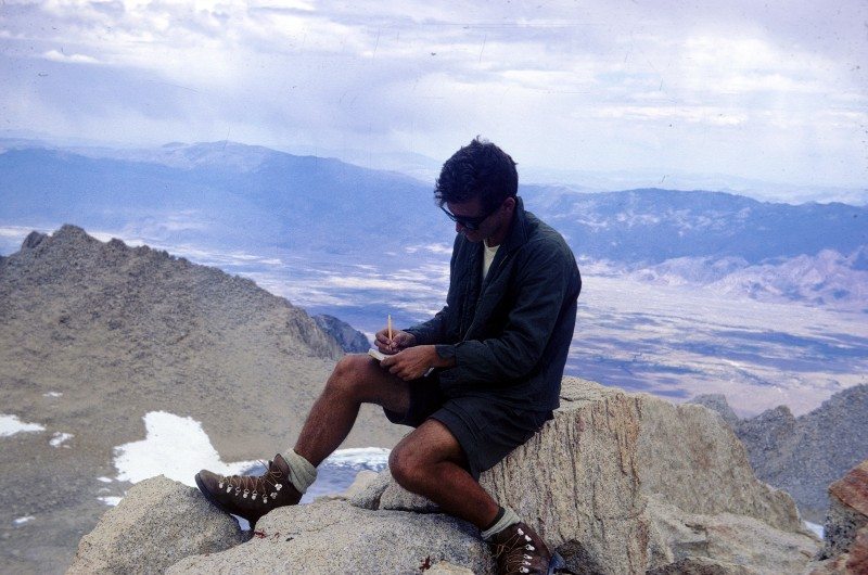 Above: Mike on top of Mt. Russell, signing in the register on top of the peak. He's wearing the new boots given to him by Kelty.  these were prototypes, and had soft soles rather than Vibram soles. The brand was Vasque, and I think these were the first boots that Vasque made.