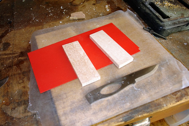 The blade blank, wood blocks (scales) and red liner material.