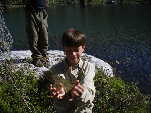 In one of those lakes Jim caught a very large trout, and I almost got there in time to get a picture of it.  Judging by the size of its tail, that sucker was huge!