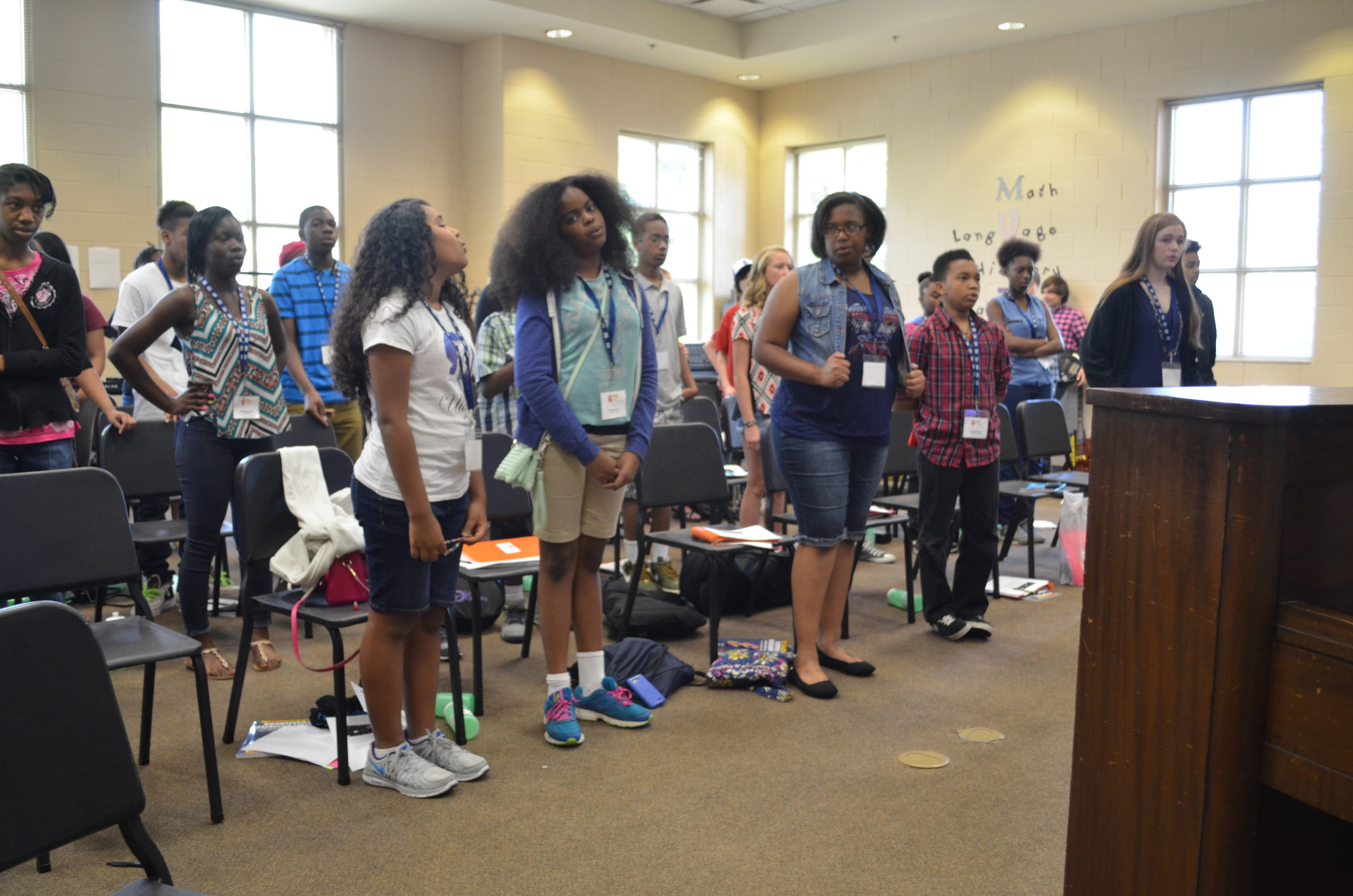 Campers Illyana Billups, Malaika Alilaw, Gena Tripp, Artis Johnston, and Trinity Ridgeway during vocal warmups