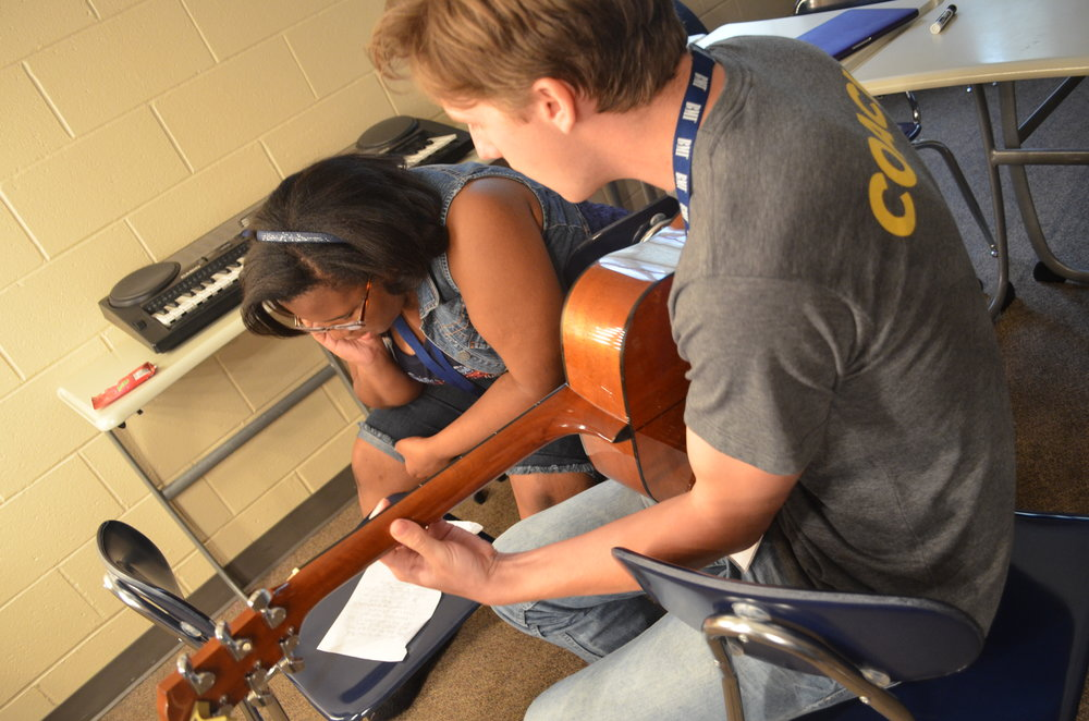 Coach Michael Suhr and Camper Gena Tripp writing a song