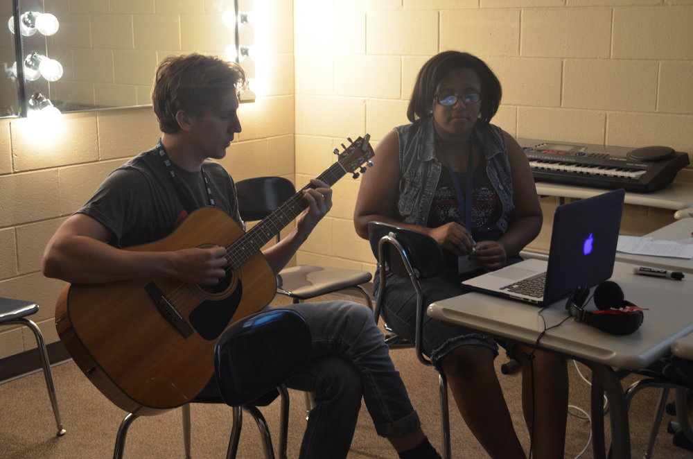 Coach Michael Suhr and Gena Tripp songwriting