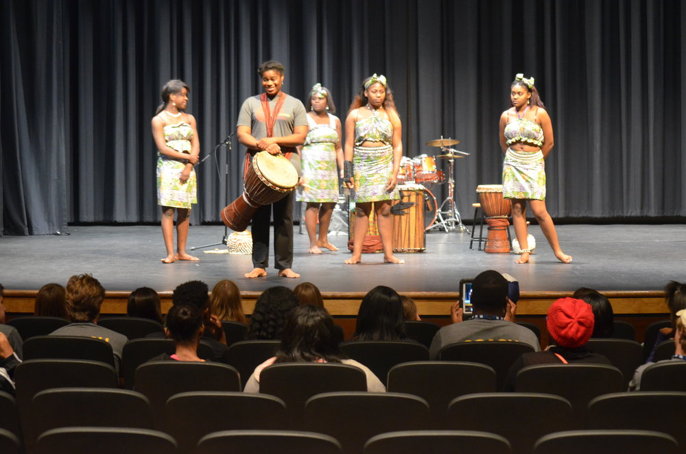 Pilar Wilder and her students performing African dance