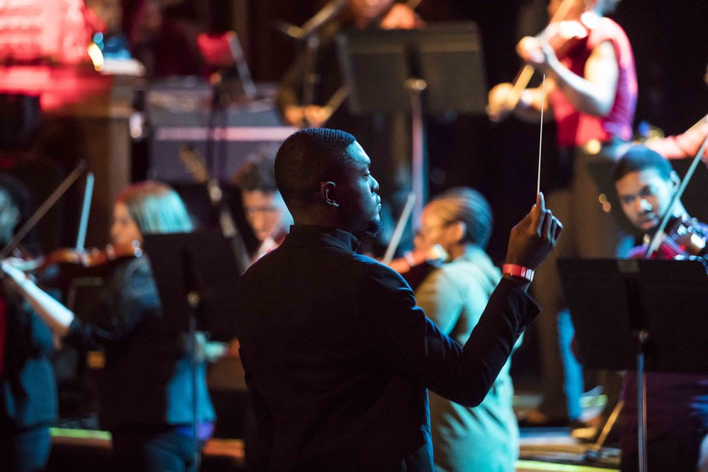 Jaris Tobler conducting the Central High School String Orchestra at O'Tis The Season in December 2018. Credit: Scott Corkery.