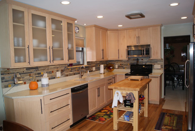 Kitchen remodel with cabinets and countertops.