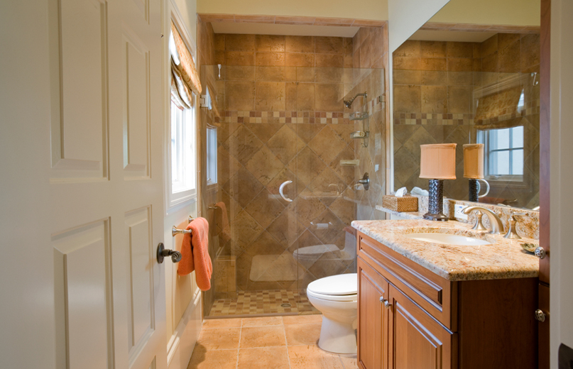 Bathroom remodel with tile and vanity.