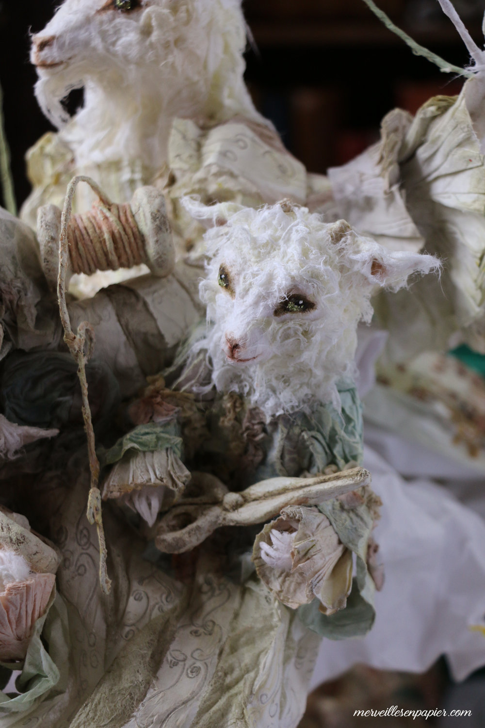 One of the Goat children  hidden under the mother's dress