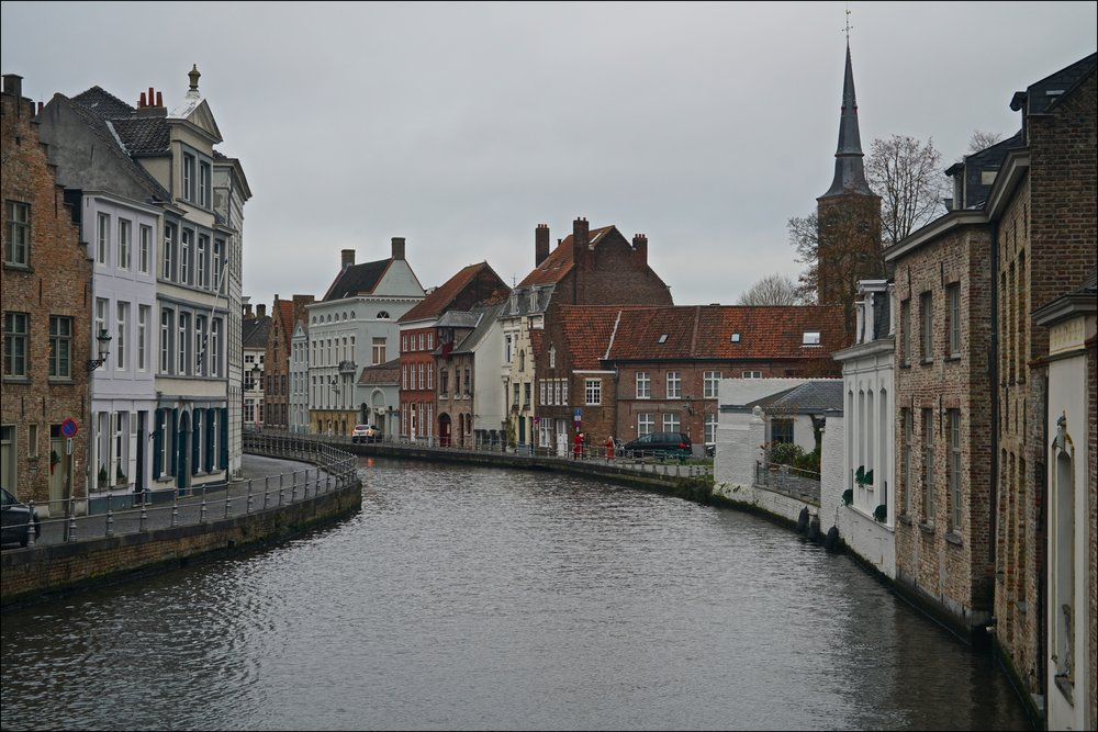 Sip on local beer while cruising the canals of Ghent -