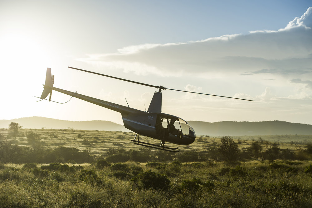 Helicopter in flight to find rhinos. Photo credit: ©Peter Chadwick – www.peterchadwick.co.za