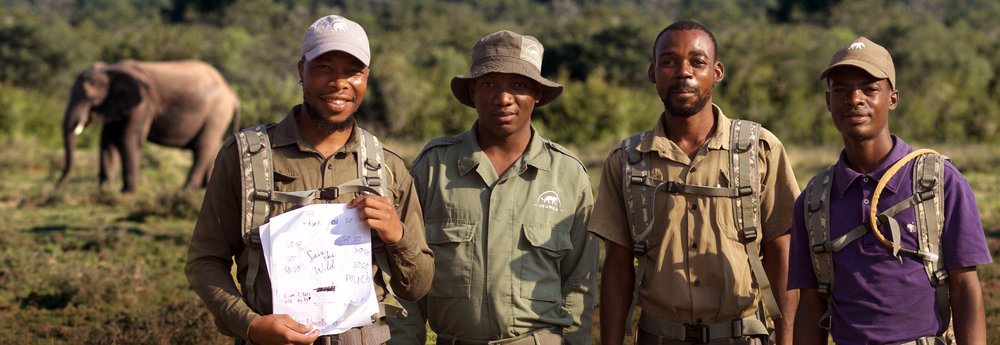 Ukuwela Rangers holding a thank you card from New York girl scouts