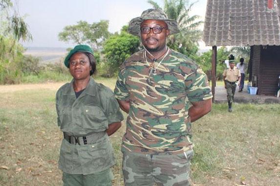 Adams Cassinga, honorary DRC Park Ranger, together with Judith, the first female park ranger at Bombo Lumene wildlife reserve, DRC..