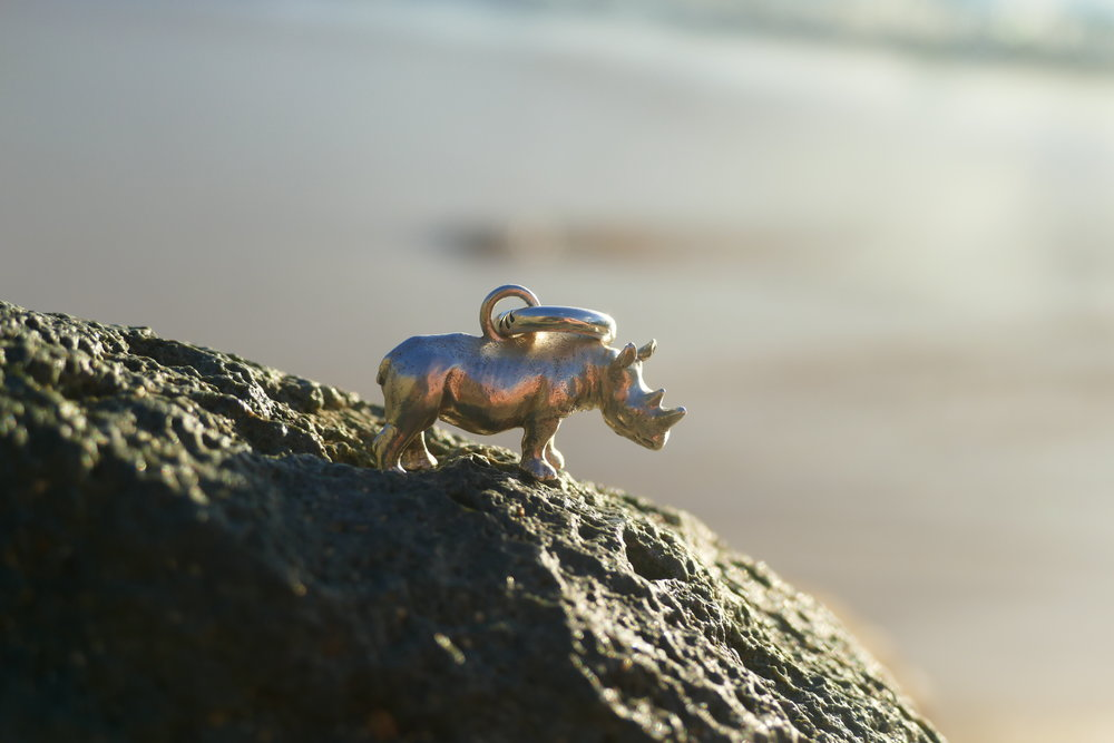 AnimalStone's Rosco the Rhino Pendant. For each sale of a solid sterling silver Rosco the Rhino pendant, AnimalStone will donate $15CAD to Wild Tomorrow Fund to support Rhino conservation. Designer and storyteller, Delane Cooper, hand finishes each one so each rhino is unique just as they are in the wild.