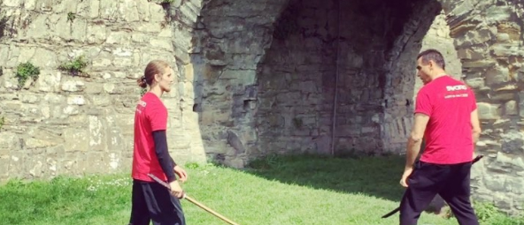 Nathan and Highlanders Adrian paul performing fight choriography at Trim castle..jpg