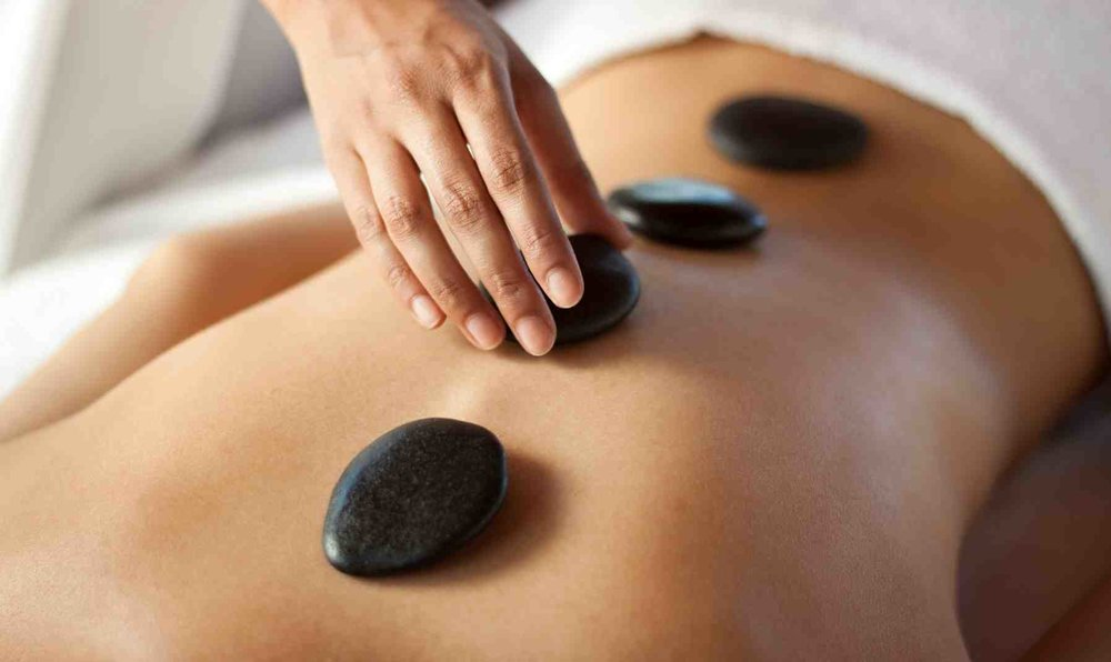 Hot Stone Massage$10-$15 Add On - The hot stones have a sedative effect that can relieve chronic pain, reduce stress and promote deep relaxation.