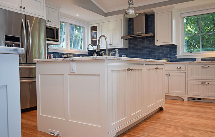 Lakehouse Kitchen - Beadboard panels make this kitchen light and airy for family lake house - More Pictures
