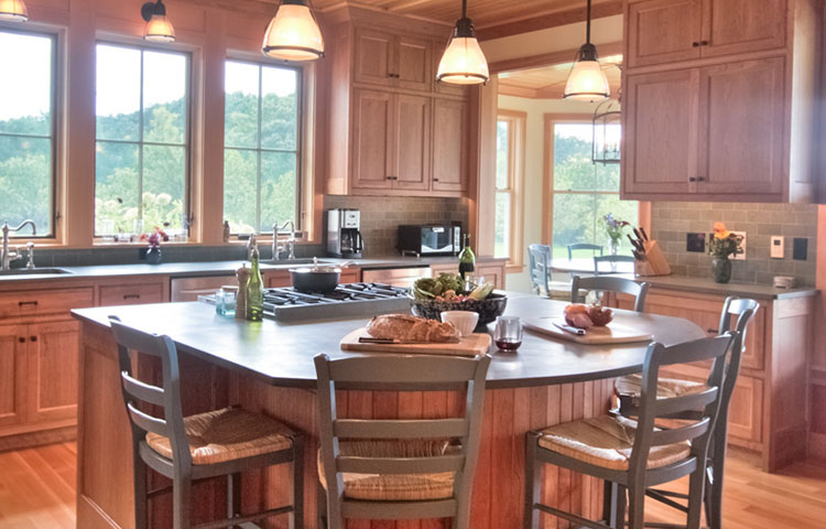 And Then There Was Wood - Bringing the outside in, this kitchen's warm wood tones on most surfaces enhance the gorgeous ample views of the forest outside.  More Pictures