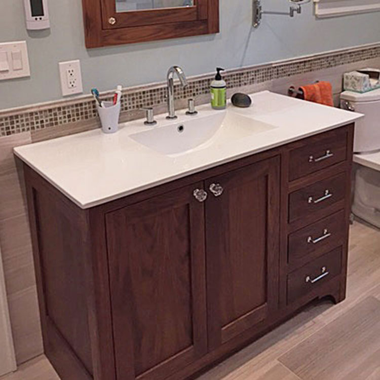 Walnut Vanity - Simple shaker flat and slab front style in this walnut vanity gives this modern clean bathroom a pop of warmth.  More Pictures
