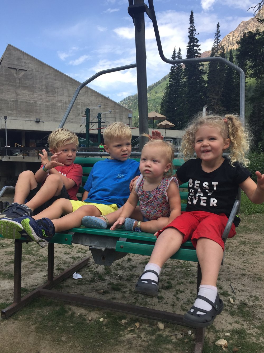 All of them together on a ski lift at Snowbird.