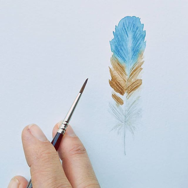 Happy #FancyFeatherFriday ! I finally got a new one on time. Just a quick one I painted this morning while I had breakfast. I couldn't get the blue light to calm down in the pic but oh well. I'm a little rusty and not happy with this one but that's okay, it takes practice! Happy to be painting a bit today since I've been feeling uncreative and working on so much other back end stuff. Exciting to share some news about that with you later today! Post your feathers, tag me in your descrip and use the hashtag so I can see your feathers! . . . . . #feather #friendsofafeather #featherpainting #fancyfeather #friyay #friday #fridayart #featherart #bohogirl #bohogirl #watercolorfeather #brushstrokes #paintedfeathers #watercolorartist #ilovetopaint #madeticreate #createcultivate #timetopaint #paintingnature #morningart #bluefeather #birdlove #paintingchallenge