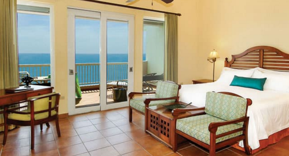 TWO BEDROOM CASITA - Two-bedroom casitas overlooking the tranquil courtyard, exotic gardens, or Caribbean Sea. Enjoy a spacious master bedroom with a king-sized bed, and second bedroom with two full-sized beds and premium linens.