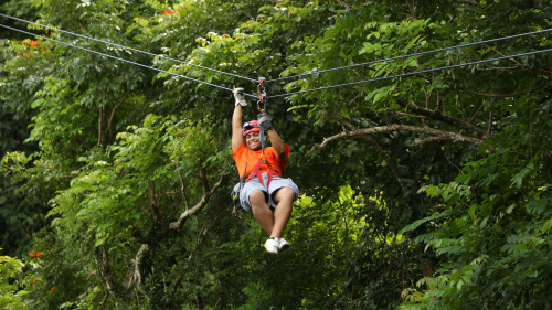 ZIPLINE ADVENTURE - The Campo Rico Ziplining Adventure is located in a hidden paradise; the setting, a 2,300 acre secluded natural jewel, composed of lush valleys, mangroves, lagoons and limestone mountains. It is the perfect setting for an unforgettable nature-adventure experience in Puerto Rico. Guests will first experience a 15-minute moderate hike through the limestone formations. After reaching the top of the first mountain you will be overwhelmed by the majestic view where the coastline meets the Atlantic Ocean.