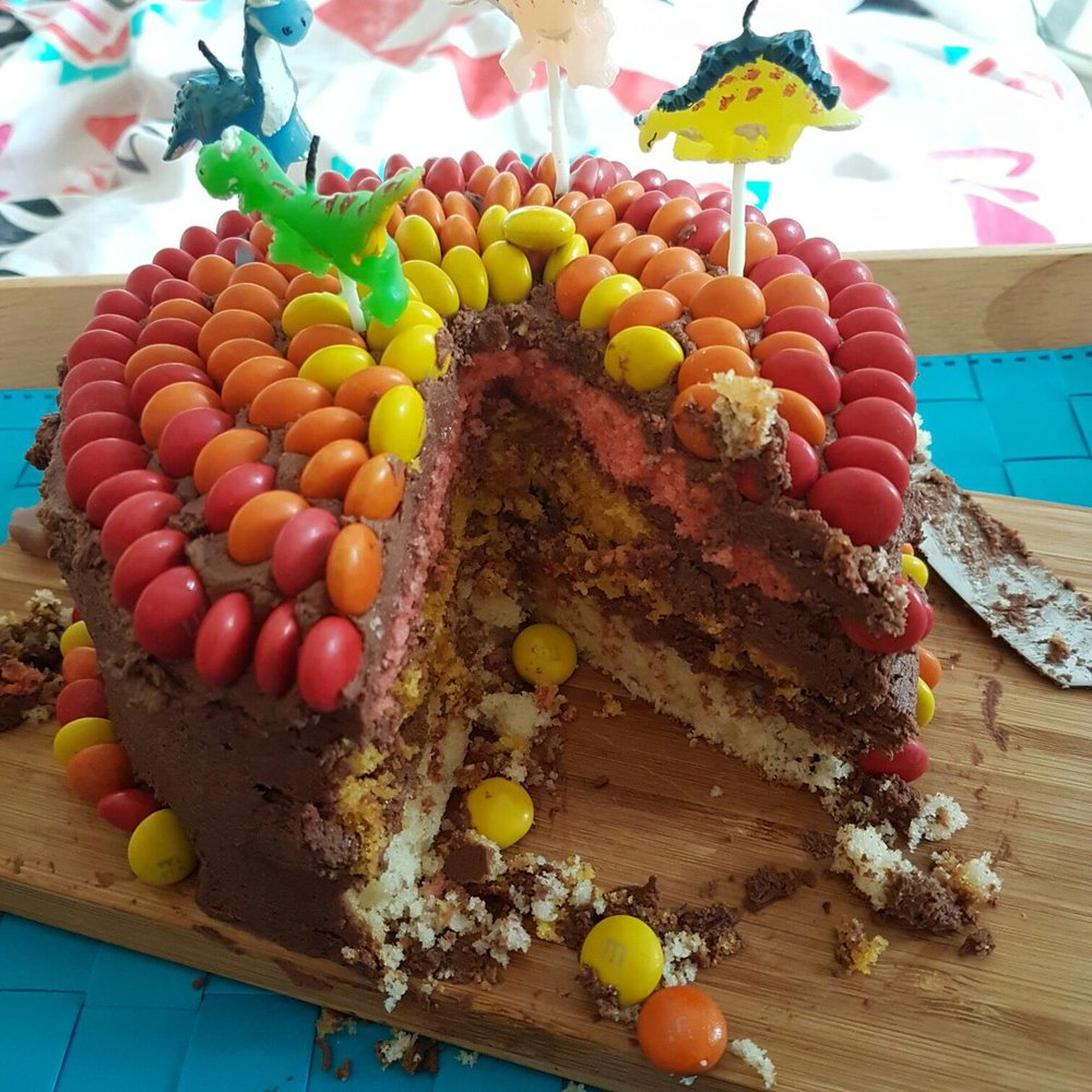 Multicoloured chocolate layer cake -