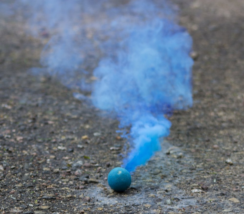 My little brother posing with the smoke bombs before he nearly threw them at me.