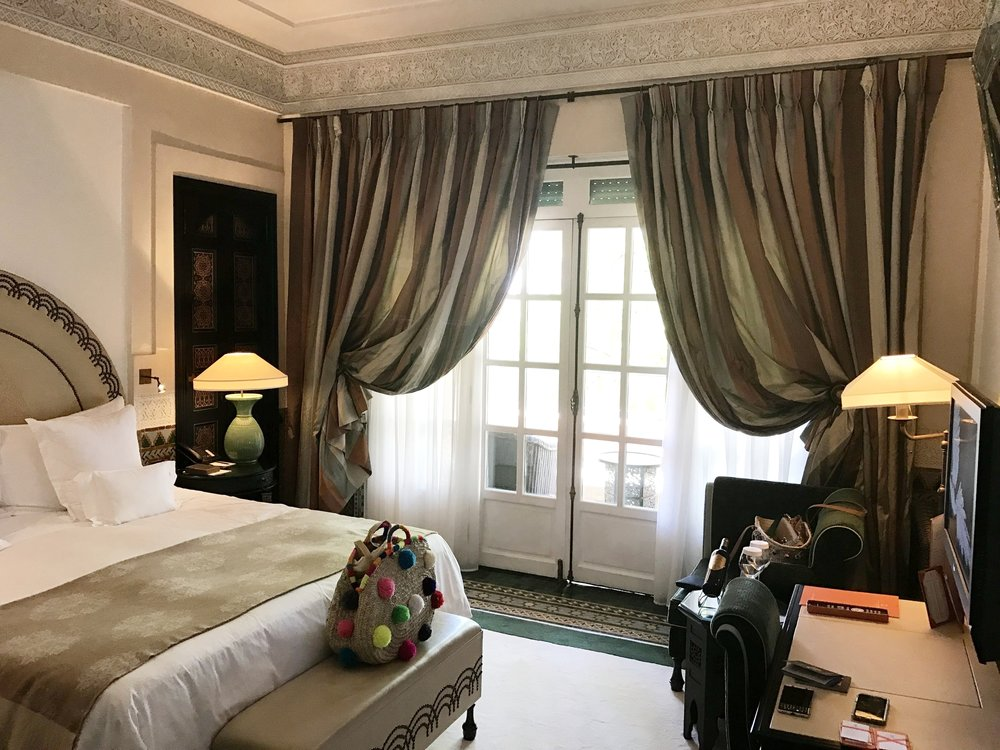 I'm usually not one to share hotel rooms but these rooms were exquisite. From the perfect colors, rug details, bottle of wine, tile inlay and original doors leading to private balcony- perfection.