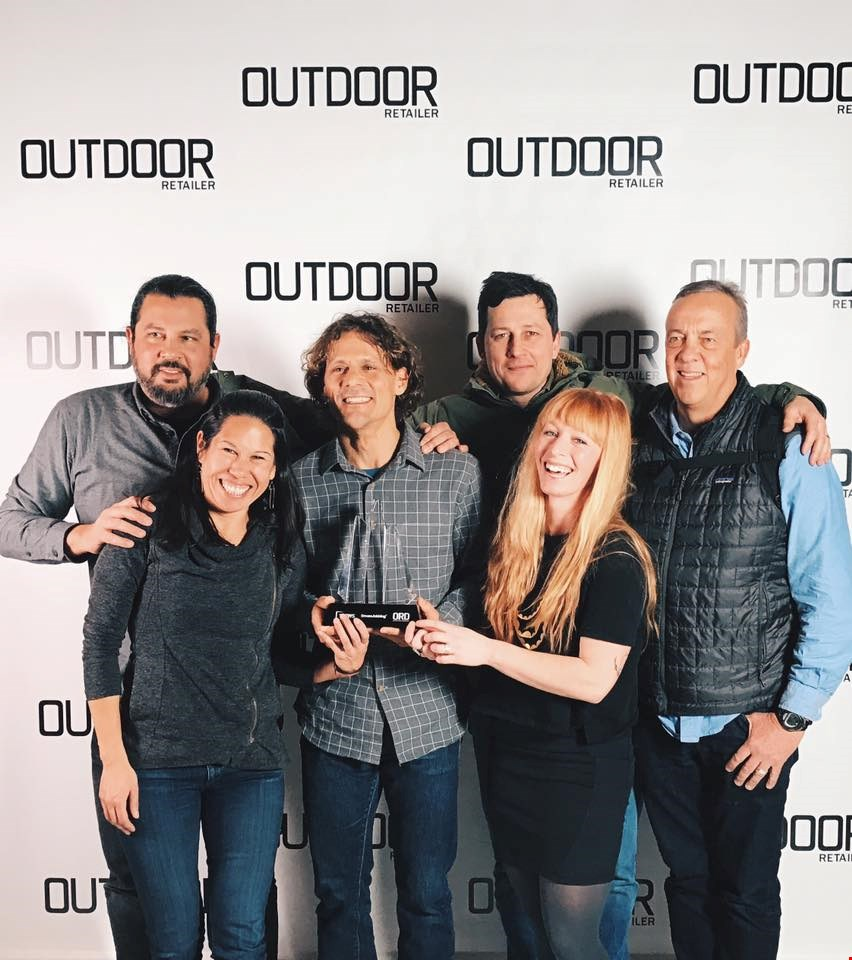 Jeff Samaripa, Linda Balfour, Chris Enlow, Tyler LaMotte, Kirsten Blackburn and Casey Sheahan accepting the 2017 Outdoor Inspiration Award at Outdoor Retailer Winter Market on behalf of KEEN Inc.