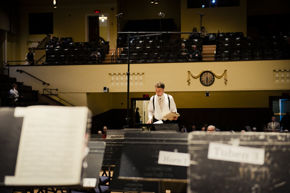 McPhee preparing for a Lexington Symphony performance at Cary Hall.